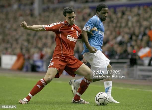 PSV Eindhoven's Jefferson Farfan and Liverpool's Alvaro Arbeloa battle for the ball