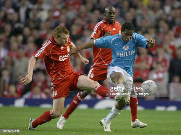 PSV Eindhoven's Jefferson Farfan and Liverpool's John Arne Riise battle for the ball