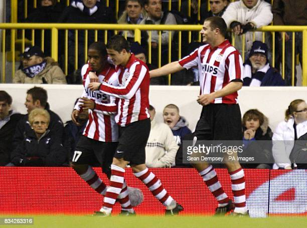 PSV Eindhoven's Jefferson Farfan celebrates with his team mates after scoring the opening goal of the game