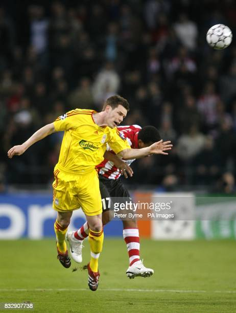 PSV Eindhoven's Jefferson Farfan fouls Liverpool's Steve Finnan as they battle for the ball