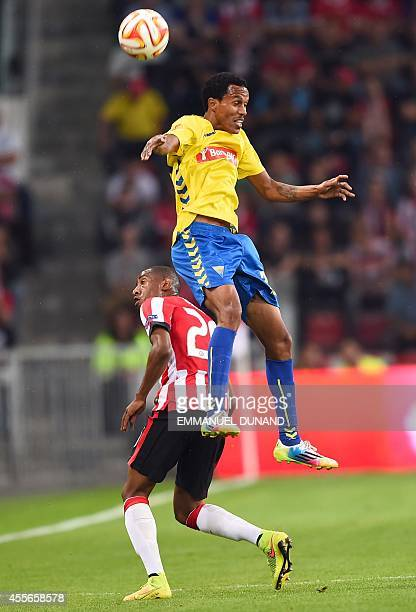 PSV Eindhoven's Joshua Brenet and Estoril's Kuca fight for the ball on September 18 2014 during a UEFA Europa League football match between PSV...