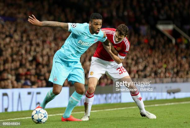 PSV Eindhoven's Jurgen Locadia and Manchester United's Matteo Darmian battle for the ball