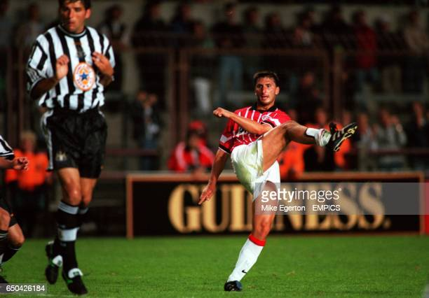 PSV Eindhoven's Luc Nilis tries a shot as Newcastle United's Philippe Albert turns his back