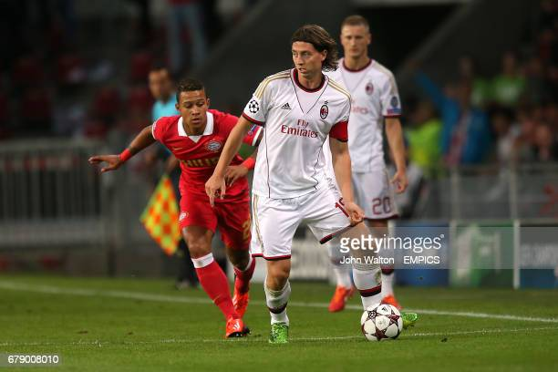 PSV Eindhoven's Memphis Depay and AC Milan's Riccardo Montolivo battle for the ball