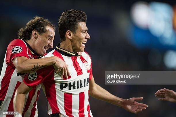 Eindhoven's Mexican defender Hector Moreno celebrates scoring the 11 during the UEFA Champions League Group B football match between PSV Eindhoven...