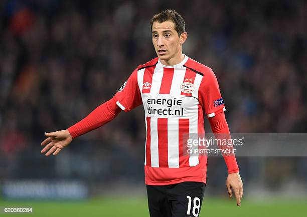 Eindhoven's Mexican midfielder Andres Guardado gestures during the UEFA Champions League group D football match between PSV Eindhoven and Bayern...