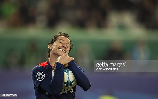 PSV Eindhoven's Mexican midfielder Andres Guardado reacts as a chance goes begging during the Group B firstleg UEFA Champions League football match...