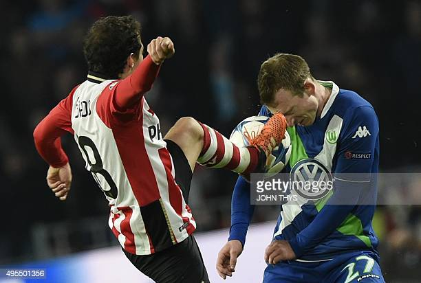 Eindhoven's Mexican midfielder Andres Guardado vies with Wolfsburg's German midfielder Maximilian Arnold during the UEFA Champions League football...