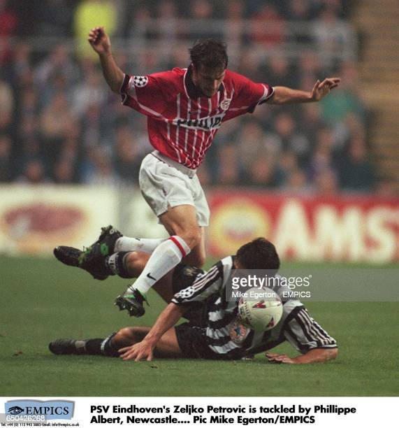 PSV Eindhoven's Zeljko Petrovic is tackled by Philippe Albert of Newcastle United