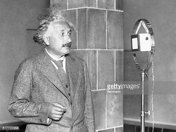 Einstein congratulating the inventor of electric lightProfessor Albert Einstein famous German scientist is seen above as he congratulated Thomas A...
