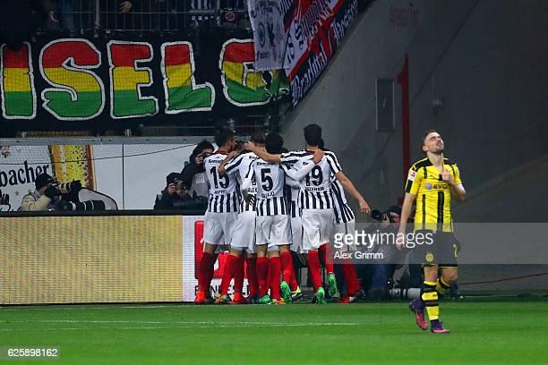 Eintracht Frankfurt players celebrate their team's first goal by Szabolcs Huszti during the Bundesliga match between Eintracht Frankfurt and Borussia...