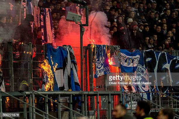 Eintracht Frankfurt supporter burning down the banners and scarfs of SV Darmstadt 98 at CommerzbankArena on December 06 2015 in Frankfurt am Main...