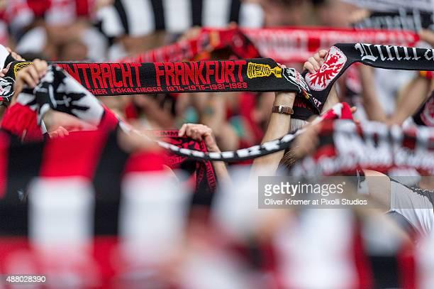 Eintracht Frankfurt supporter singing and waving their scarves at CommerzbankArena on September 12 2015 in Frankfurt am Main Germany