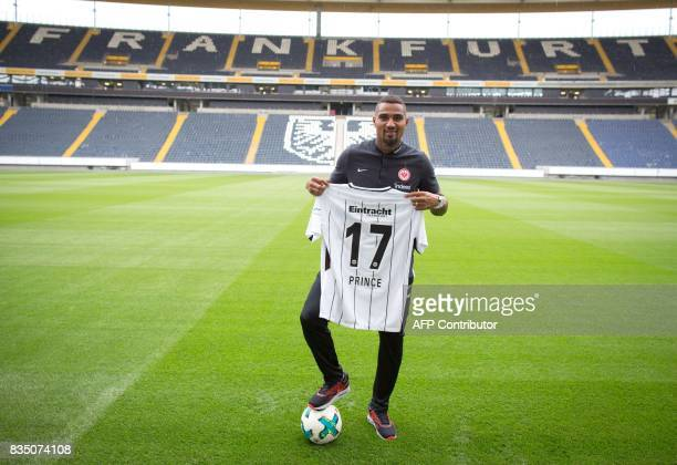 Eintracht Frankfurt's new midfielder KevinPrince Boateng poses with his shirt in Frankfurt am Main on August 18 2017 Boateng could feature for...