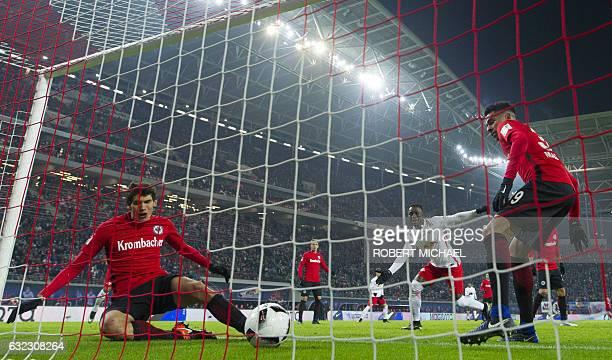 Eintracht Frankfurt's Spanish defender Jesus Vallejo and Spanish midfielder Omar Mascarell react after scoring the third goal during the German first...