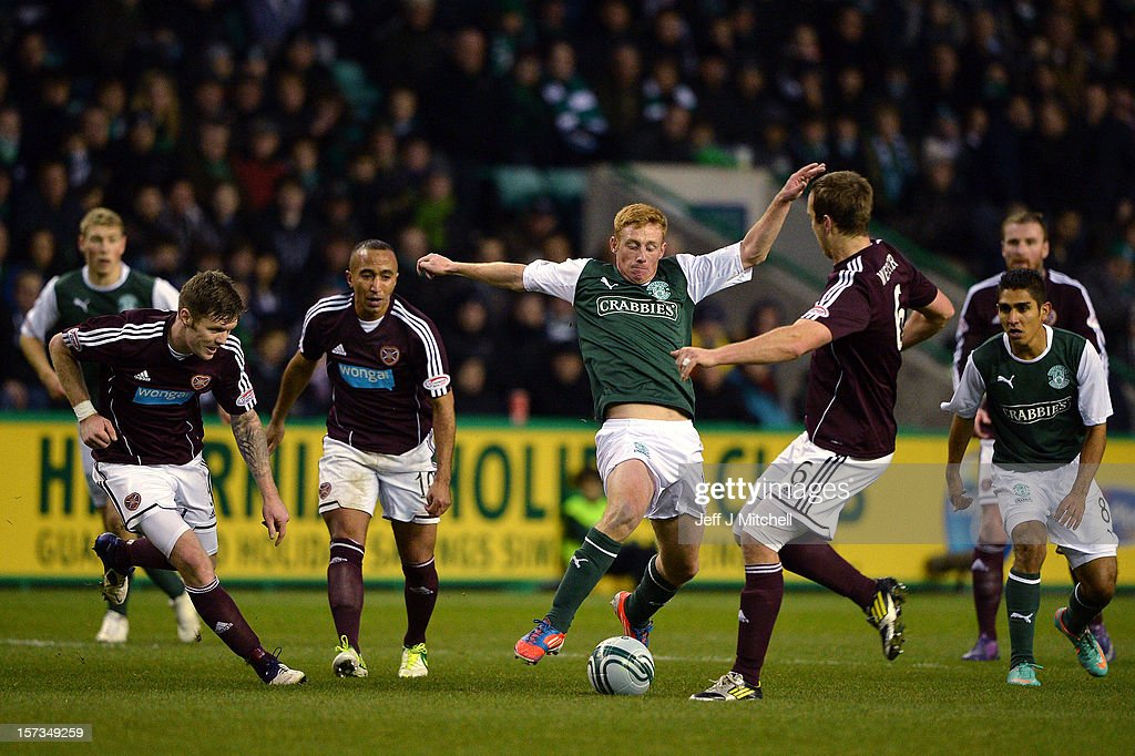 Eion Doyle of Hibernian tackles <a gi-track='captionPersonalityLinkClicked' href=/galleries/search?phrase=Andy+Webster&family=editorial&specificpeople=235515 ng-click='$event.stopPropagation()'>Andy Webster</a> of Hearts during the Scottish Cup match between Hibernian and Hearts at Easter Road Stadium on December 2, 2012 in Edinburgh, Scotland.