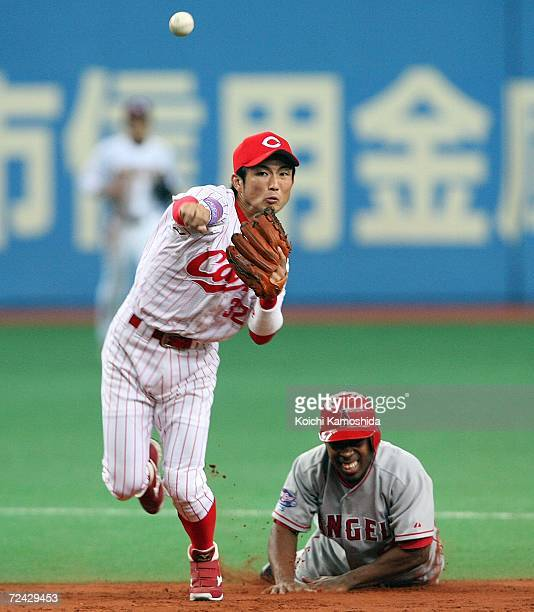 Eishin Soyogi of Hiroshima Toyo Carp throws after forcing out Chone Figgins of the Los Angeles Angels of Anaheim during the Aeon All Star Series Day...