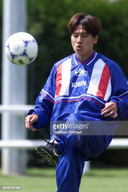 Eisuke Nakanishi of Japan juggles the ball during a training session on June 17 1998 in AixlesBains France