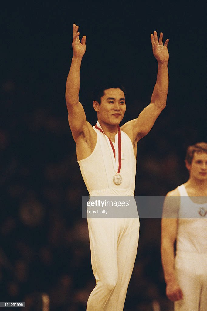 Eizo Kenmotsu of Japan with the gold medal after winning the Men's Parallel Bars event on 28th October 1978 during the World Artistic Gymnastics...