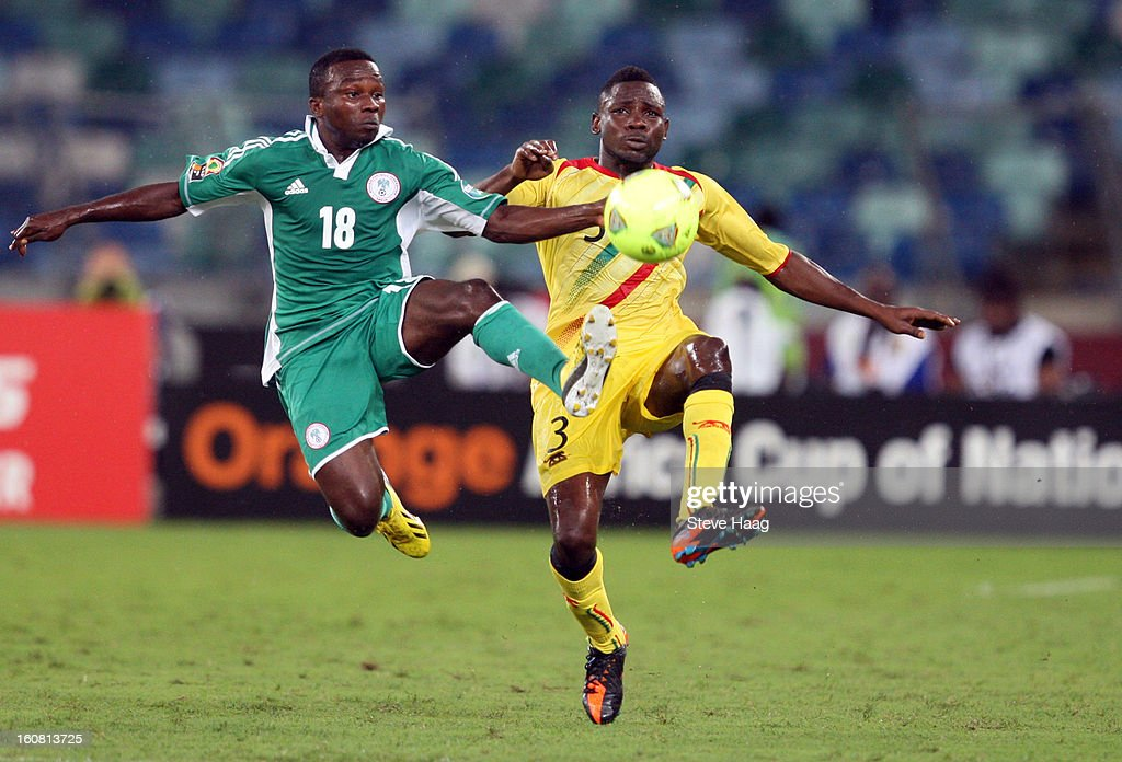Ejike Uzoenyi of Nigeria competes for the ball with Adama Tamboura of Mali during the 2013 African Cup of Nations Semi-Final match between Mali and Nigeria at Moses Mahbida Stadium on February 06, 2013 in Durban, South Africa.
