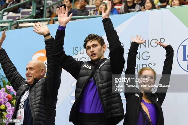 Ekaterina Alexandrovskaya and Harley Windsor of Australia celebrate at kiss and cry during the 3rd day of the World Junior Figure Skating...
