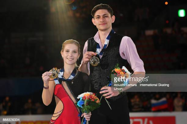 Ekaterina Alexandrovskaya and Harley Windsor of Australia pose on the podium after competing in the pairs free skating during the ISU Junior Senior...