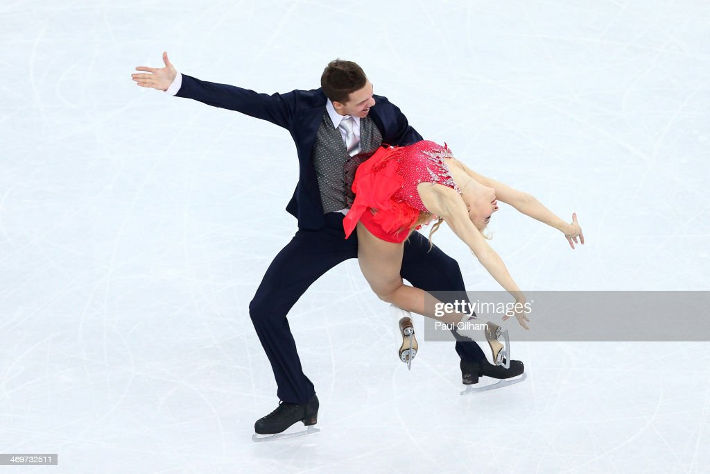 <a gi-track='captionPersonalityLinkClicked' href=/galleries/search?phrase=Ekaterina+Bobrova&family=editorial&specificpeople=4607767 ng-click='$event.stopPropagation()'>Ekaterina Bobrova</a> and <a gi-track='captionPersonalityLinkClicked' href=/galleries/search?phrase=Dmitri+Soloviev&family=editorial&specificpeople=4607766 ng-click='$event.stopPropagation()'>Dmitri Soloviev</a> of Russia compete during the Figure Skating Ice Dance Short Dance on day 9 of the Sochi 2014 Winter Olympics at Iceberg Skating Palace on February 16, 2014 in Sochi, Russia.