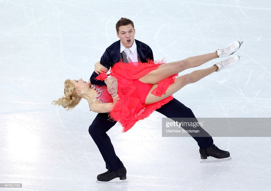 <a gi-track='captionPersonalityLinkClicked' href=/galleries/search?phrase=Ekaterina+Bobrova&family=editorial&specificpeople=4607767 ng-click='$event.stopPropagation()'>Ekaterina Bobrova</a> and <a gi-track='captionPersonalityLinkClicked' href=/galleries/search?phrase=Dmitri+Soloviev&family=editorial&specificpeople=4607766 ng-click='$event.stopPropagation()'>Dmitri Soloviev</a> of Russia compete in the Figure Skating Team Ice Dance - Short Dance during day one of the Sochi 2014 Winter Olympics at Iceberg Skating Palace on February 8, 2014 in Sochi, Russia.