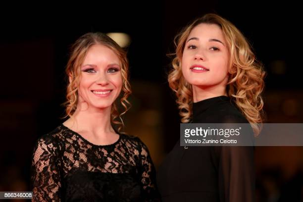 Ekaterina Buscemi and Sabrina Martina walk the red carpet for 'La Ragazza Nella Nebbia' during the 12th Rome Film Fest at Auditorium Parco Della...