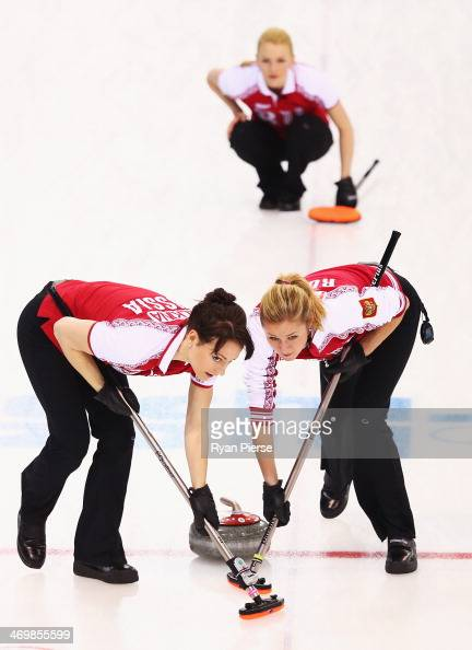 Ekaterina Galkina and Margarita Fomina of Russia compete during the Curling Women's Round Robin match between Russia and Great Britain on day ten of...