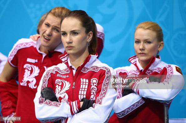 Ekaterina Galkina Anna Sidorova and Alexandra Saitova of Russia compete during the Curling Women's Round Robin match between Russia and Great Britain...