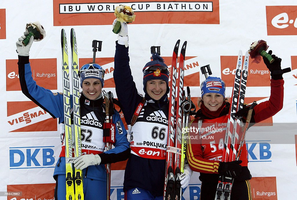 Ekaterina Iourieva of Russia (C) celebrates her victory, next to second placed Michela Ponza of Italy (L) and third Martina Glagow of Germany on the podium of the women's biathlon World Cup 15 km individual race in Pokljuka, 13 December 2007.