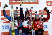 Ekaterina Iourieva of Russia celebrates her victory next to second placed Michela Ponza of Italy and third Martina Glagow of Germany on the podium of...