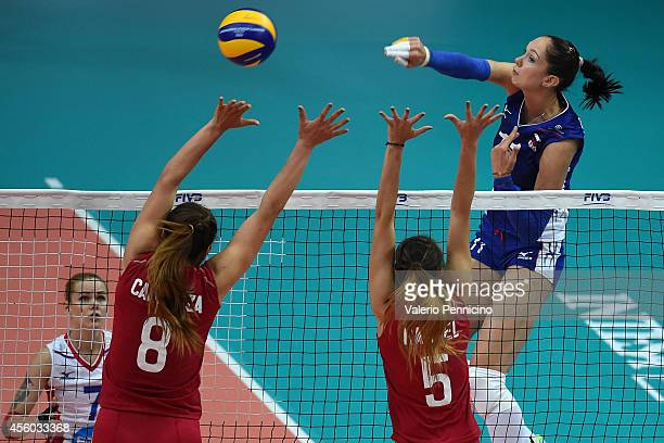Ekaterina Kosianenko of Russia smashes as Dulce Carranza and Andrea Rangel of Mexico block during the FIVB Women's World Championship pool C match...