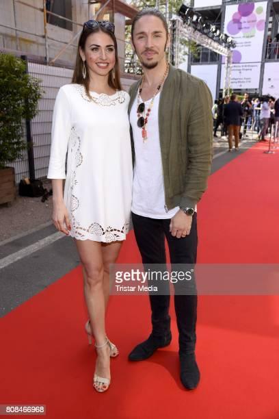 Ekaterina Leonova and Gil Ofarim attend the Riani Fashion Show Spring/Summer 2018 at Umspannwerk Kreuzberg on July 4 2017 in Berlin Germany