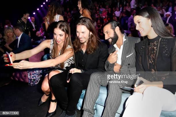 Ekaterina Leonova Gil Ofarim Massimo Sinato and Rebecca Mir attend the Guido Maria Kretschmer Fashion Show Autumn/Winter 2017 presented by OTTO at...