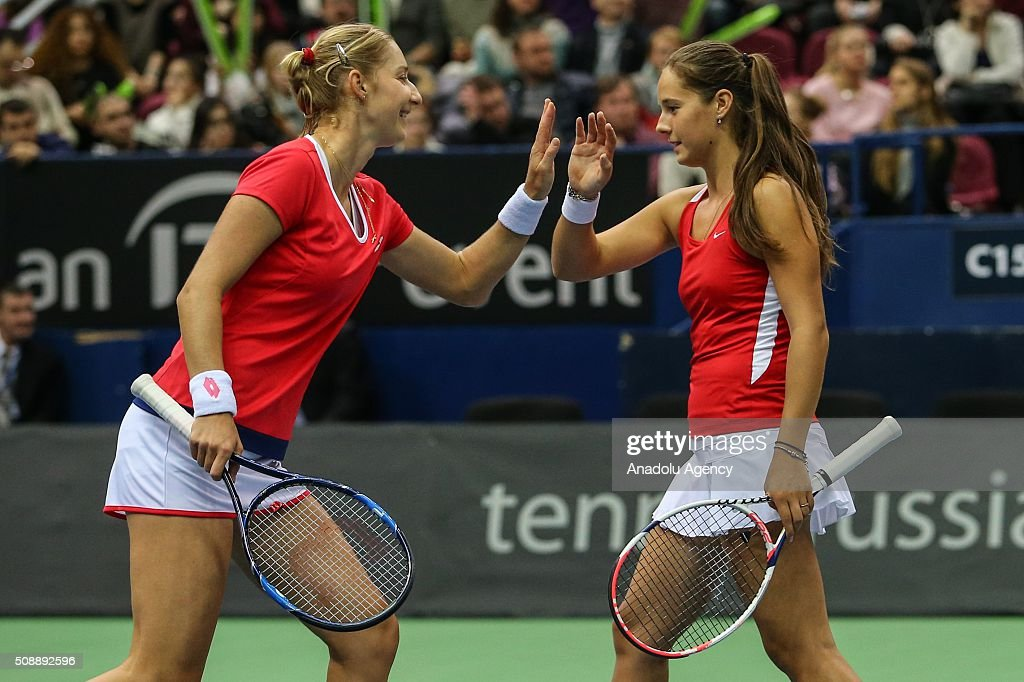 Ekaterina Makarova (L) and Daria Kasatkina (R) of Russia in an action against Cindy Burger and Arantxa Rus of Netherlands during the Fed Cup World Group First round tennis match in Moscow, Russia on February 7, 2016.