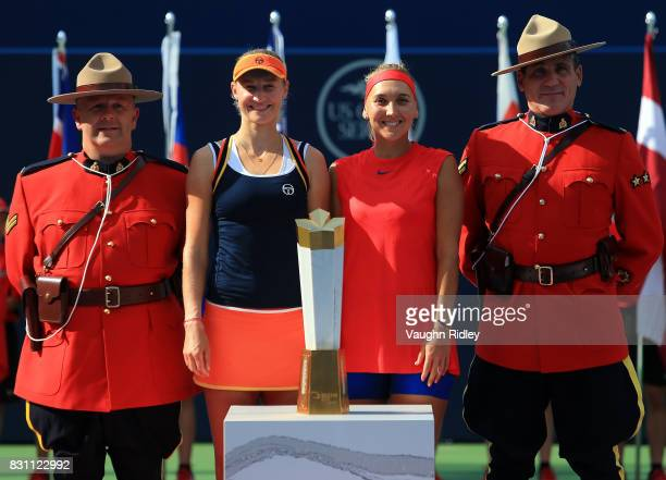 Ekaterina Makarova and Elena Vesnina of Russia and Canadian Mounties with the winners trophy following their victory over AnnaLena Groenefeld of...