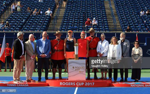 Ekaterina Makarova and Elena Vesnina of Russia and VIP's with the winners trophy following their victory over AnnaLena Groenefeld of Germany and...