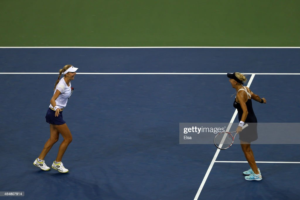 Ekaterina Makarova and Elena Vesnina of Russia celebrate after defeating Martina Hingis of Switzerland and Flavia Pennetta of Italy during their women's doubles final match on Day Thirteen of the 2014 US Open at the USTA Billie Jean King National Tennis Center on September 6, 2014 in the Flushing neighborhood of the Queens borough of New York City. Makarova and Vesnina defeated Hingis and Pennetta in three sets 2-6, 6-3, 6-2.