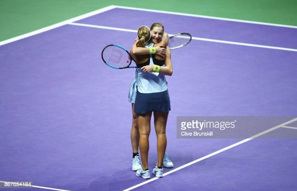 Ekaterina Makarova and Elena Vesnina of Russia celebrate victory in the doubles match against YiFan Xu of China and Gabriela Dabrowski of Canada...
