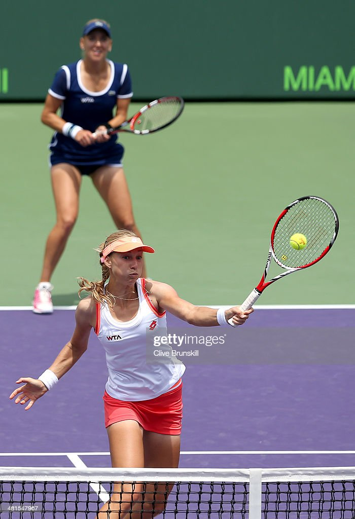 <a gi-track='captionPersonalityLinkClicked' href=/galleries/search?phrase=Ekaterina+Makarova&family=editorial&specificpeople=2364239 ng-click='$event.stopPropagation()'>Ekaterina Makarova</a> and <a gi-track='captionPersonalityLinkClicked' href=/galleries/search?phrase=Elena+Vesnina&family=editorial&specificpeople=552598 ng-click='$event.stopPropagation()'>Elena Vesnina</a> of Russia in action against Martina Hingis of Switzerland and Sabine Lisicki of Germany during their final match during the final of the Sony Open at Crandon Park Tennis Cente on March 30, 2014 in Key Biscayne, Florida.