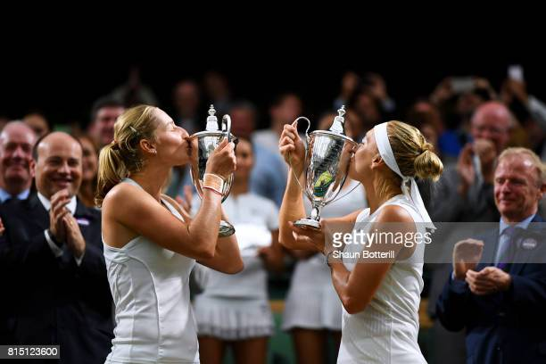 Ekaterina Makarova and Elena Vesnina of Russia kiss their winners trophies after victory in the Ladies Doubles Final against HaoChing Chan of Chinese...