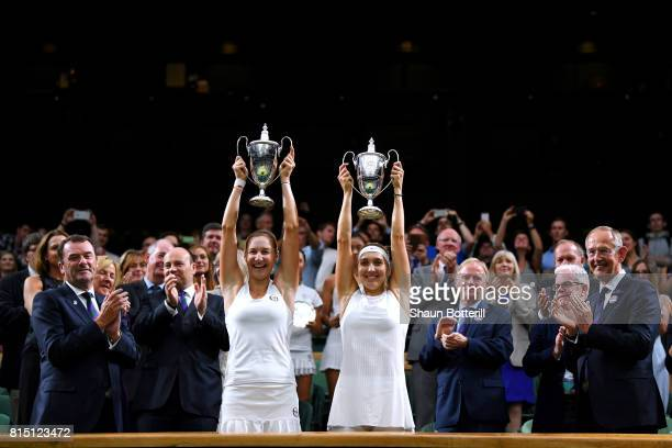 Ekaterina Makarova and Elena Vesnina of Russia lift their winners trophies after victory in the Ladies Doubles Final against HaoChing Chan of Chinese...