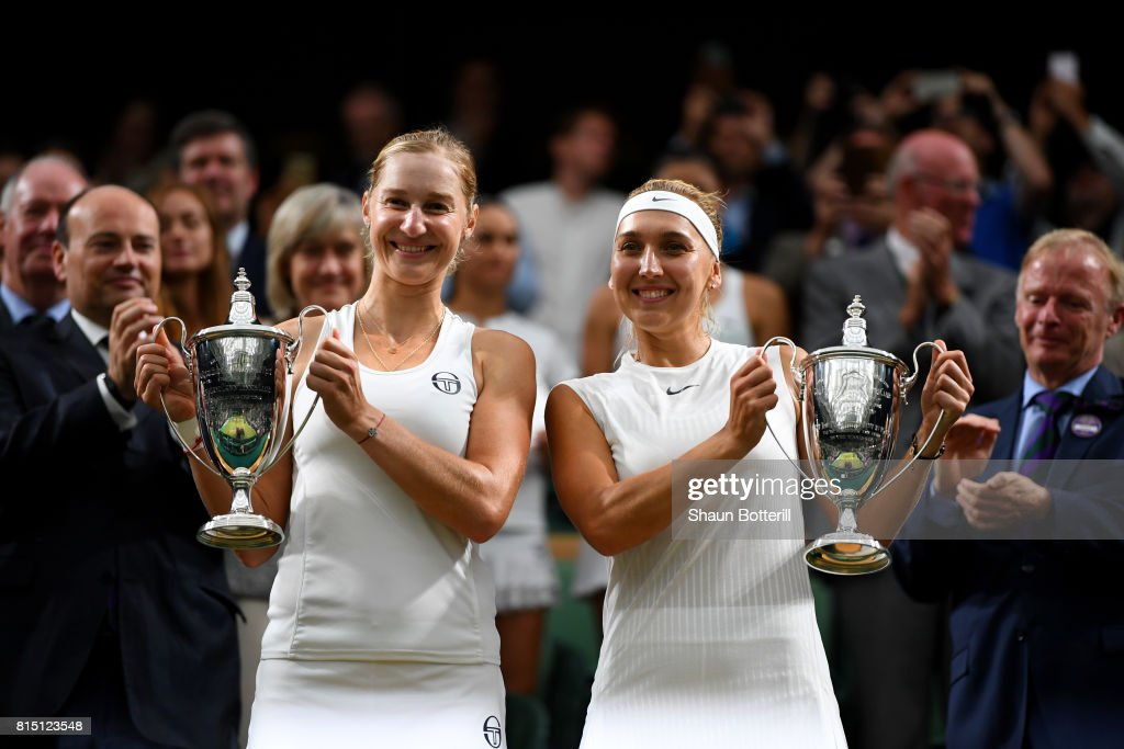 Ekaterina Makarova (L) and Elena Vesnina of Russia lift their winners trophies after victory in the Ladies Doubles Final against Hao-Ching Chan of Chinese Taipei and Monica Niculescu of Romania on day twelve of the Wimbledon Lawn Tennis Championships at the All England Lawn Tennis and Croquet Club at Wimbledon on July 15, 2017 in London, England.