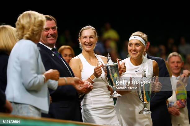 Ekaterina Makarova and Elena Vesnina of Russia pose with their winners trophies after victory in the Ladies Doubles Final against HaoChing Chan of...