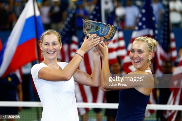 Ekaterina Makarova and Elena Vesnina of Russia poses with the trophy after defeating Martina Hingis of Switzerland and Flavia Pennetta of Italy in...