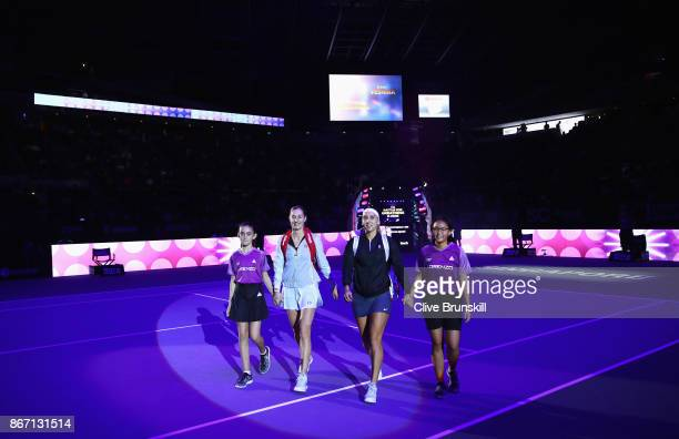 Ekaterina Makarova and Elena Vesnina of Russia walk out in the doubles match against YiFan Xu of China and Gabriela Dabrowski of Canada during day 6...