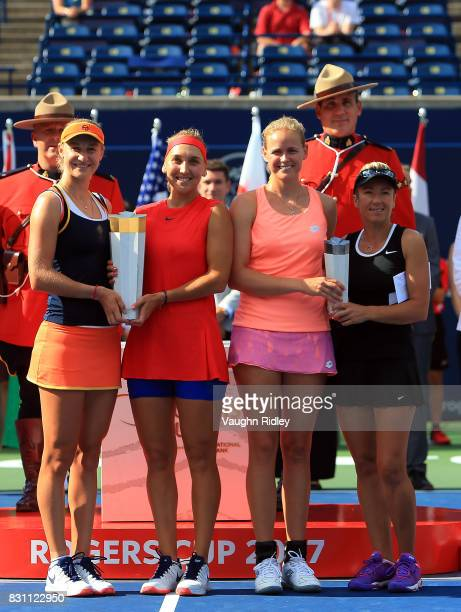 Ekaterina Makarova and Elena Vesnina of Russia with the winners trophy and AnnaLena Groenefeld of Germany and Kveta Peschke of Czech Republic with...