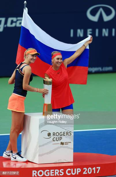 Ekaterina Makarova and Elena Vesnina of Russia with the winners trophy following their victory over AnnaLena Groenefeld of Germany and Kveta Peschke...